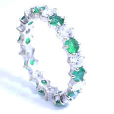 18 karat Eternity ring set with emeralds and diamonds || diamonds 0.95 ct in total and emeralds 1.2 ct in total.