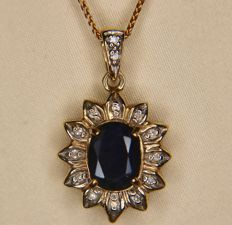 ca. 1960 Vintage 9Kt. Gold chain and a pendant set with a natural Sapphire approx. 1.55ct. and surrounded by with 12 small 8/8 diamonds in excellent state