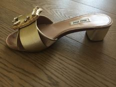 Miu Miu - mules in metallised leather and velvet with decoration