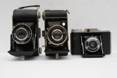 A lot of 3 bellows cameras an Ensign Ranger II, an Adox: Golf 45 S and a Duxo bellows camera various production years