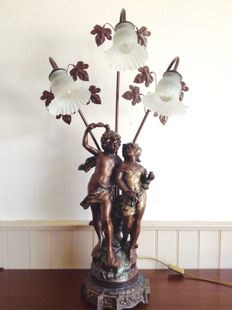 Floor lamp featuring a couple in love