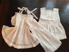 Three gorgeous French antique treated doll dresses with lace