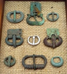Ancient bronze and silver buckles of different periods and cultures, in the frame for the exposure, 19-50 mm. silver 8.38 grams