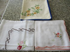 Lot of three hand-embroidered table doilies.