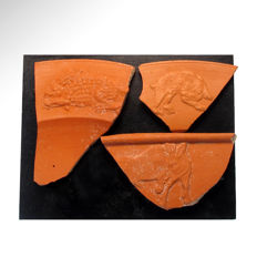 Three Roman Terrasigillata Fragments with Animals, Piece with hare= 8.8 cm L, with wild boar= 9.2 cm L, with bear= 6.9 cm (3)
