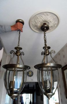 Two large candlelight lamps in heavy quality metal with cut glass and ornate detailed finish in antique bronze colour