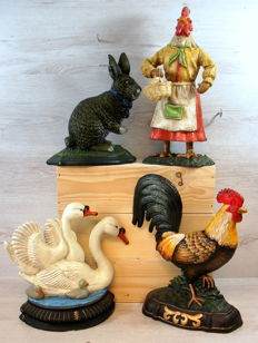 Collection of decorative cast iron doorstops