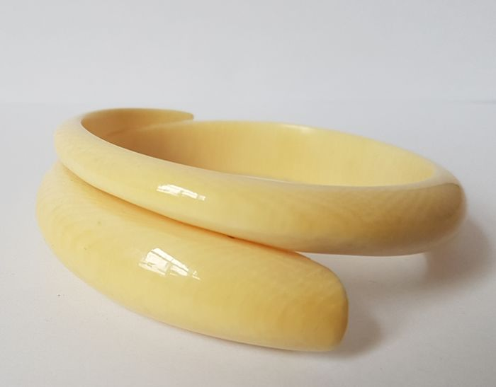 An antique ivory 'snake-shaped' bracelet