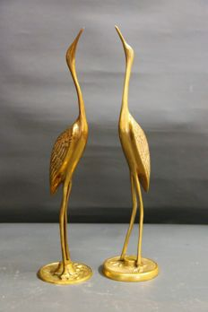 Two herons in brass
