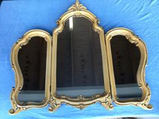 Triptych mirror in a wooden frame