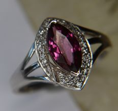 White 9Kt. Gold ring with a strong pink coloured clear Rhodolite enchanted by 36 point diamonds. [I/VS2] for a total of 0.74ct in an excellent condition