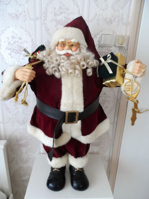Statue of Santa Claus loaded with packages