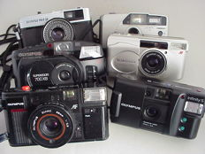 Six Olympus compact cameras: Quickflash AFL, Trip 35, Infinity S (AM-100), Superzoom 700XB, Newpic XB and Superzoom 70G