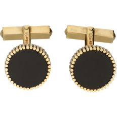 14 kt - Yellow gold cufflinks, each set with an onyx