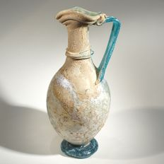 Roman two coloured glass pitcher with emerald green handle, foot and trailing - 20 cm