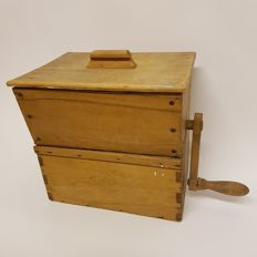 World War II wooden chest with hand tool for separating flour/grain