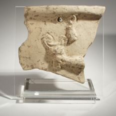 Fragment of a terracotta plaquette (pinax) Size 9 cm