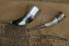 Two beautiful celtic drinking horns, one with silver trim.