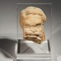 Greek fragment of the head of a comic actor, terracotta. Size 5 cm