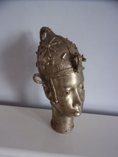 A copper sculpture of an African head
