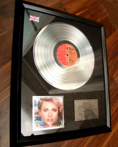 Olivia Newton-John's Greatest Hits 300,000 UK sales Award
