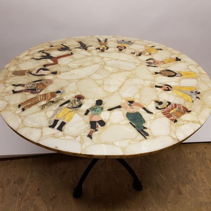 Marble table inlaid with precious stones on a cast iron base
