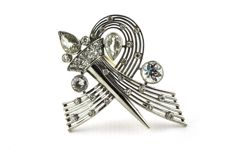 One of a Kind Exclusive Torch Brooch with Diamonds Total +/- 5.25CT set on Stamped 750/18k White Gold
