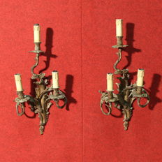 Pair of chiselled ormolu sconces - France, early 20th century