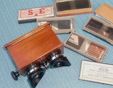 Stereoscope from wood and bakelite + 65 glass stereo images - approx. 1900
