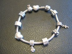 Pandora Bracelet in sterling silver with 10 silver charms. weight is 38 grams - lenght 19 cm