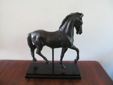 Beautiful horse on wooden plinth