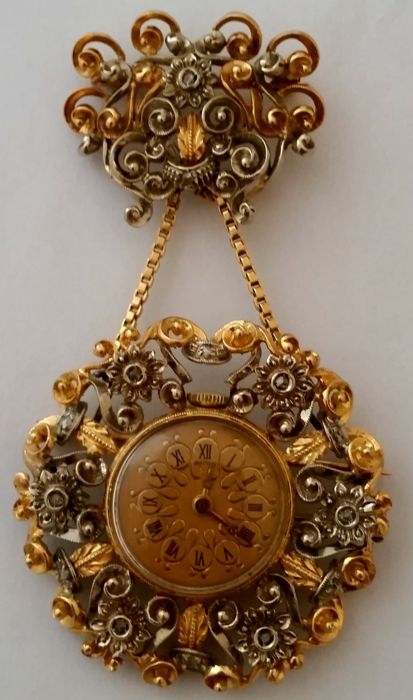 Double 18 kt white and yellow gold brooch with diamonds, pendant with Swiss made watch (17 jewels).