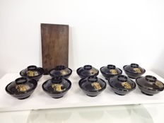Ten antique lacquerware bowls, maki-e design of kabuto (helmet) - Japan - 1909 (Meiji 42)