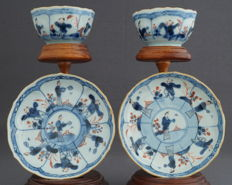 Contoured cups and saucers with decoration of men and women in classical landscape – China – first half of 18th century