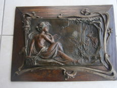 Seated nude at the edge of the wood - embossed plaque