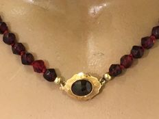 Antique garnet necklace with a gold clasp