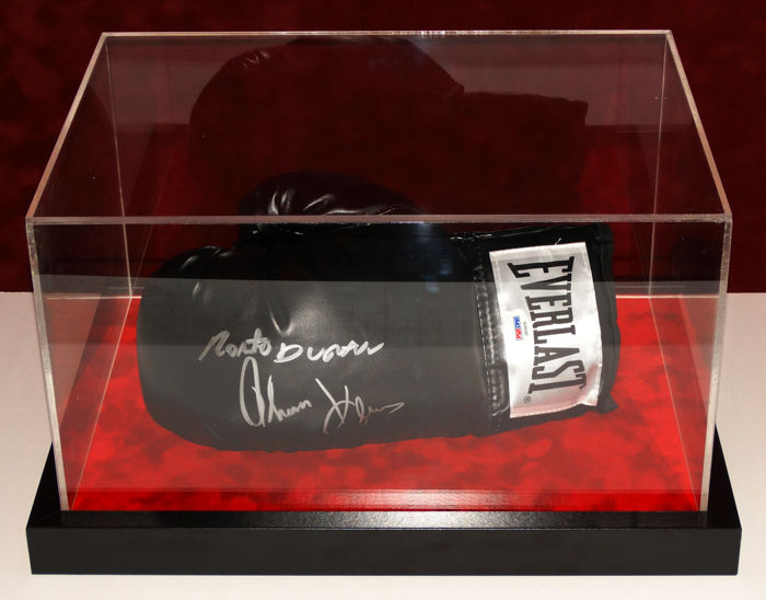 "Roberto ""Hands of Stone"" Duran and Thomas ""The Hitman"" Hearns signed boxing glove in a display case + Certificate of Authenticity"