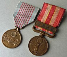 WWII Japanese medals;  2600th Anniversary Japanese Empire + Manchuria incident medal.
