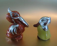 Porcelain salt and pepper set with 800/1000 silver, pelican and duck