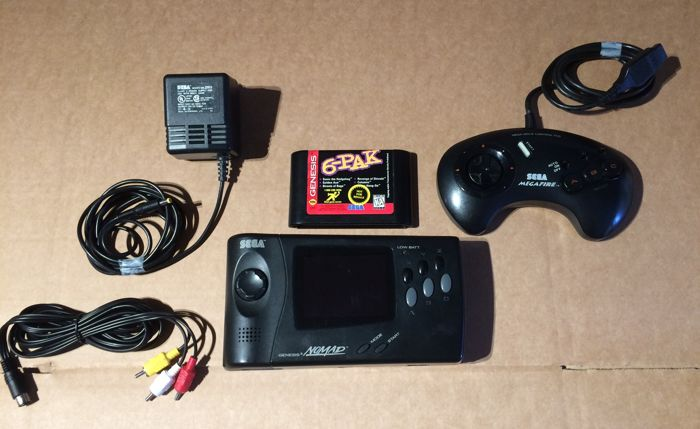 Sega Genesis Nomad portable console with tv connection set