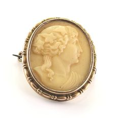 Antique Art Nouveau brooch from rolled gold and set with removable Vesuvius lava cameo, Naples, Italy circa 1880