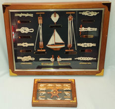 Two mahogany wooden frames with skipper knots and ship rigs