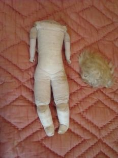 Antique leather doll body with original mohair wig - France
