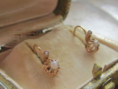 Stud earrings, made of 18 kt rose gold, with eagle's head stamp