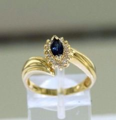 Ring in 14 kt 585/1000 yellow gold on white gold Set with diamonds and genuine sapphire