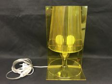 Kartell - Transparent yellow table lamp