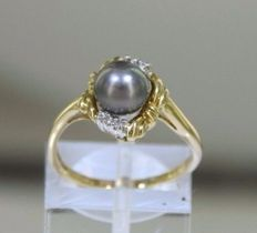 14 kt 585/1000 solid gold ring with Genuine diamonds + pearl Diameter 6.6 mm