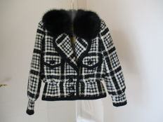 Frank Govers - A black and white wool jacket with fur collar.