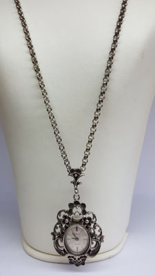 925 silver necklace set with an antique, hand wound watch pendant.