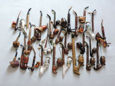 49 pipes in beautiful condition and unused - period 1950 to 1970.